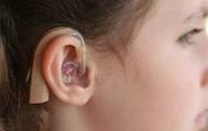 Deanne has a hearing aid