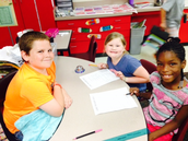 Jace mentoring in the 1st Grade Classroom