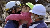 Children being taken into care after the earthquake