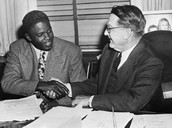 Jackie Robinson Next To Branch Rickey Signing With The Dodgers in 1947