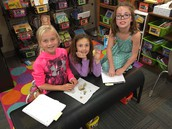 Lynden, Tori, and Sophie work together to name the rock properties.