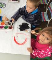Oona and Finn start the dot mural
