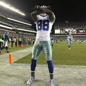 "This is Dez celebrating because he scored a touch down. He calls it ""Throwing up the X"""