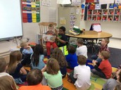 Guest readers, Daryl & Cooper, reading to Mrs. Beckstead's class.