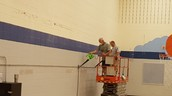 Cleaning the gym walls
