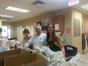 Willa, Bill & Dianne pack groceries for needy families!
