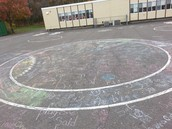 Students from a variety of classes wrote their spelling words on the playground