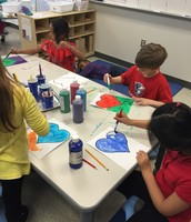We painted hearts to use to make a puzzle.