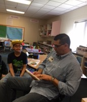 Mr. Arango reading to the class in Spanish