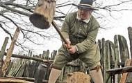 A Pilgrim working to chop wood