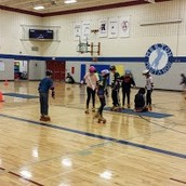 5th and 6th graders are rollerskating in PE