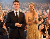 Taylor and her brother at an award ceremony and Taylor winning with her brother.