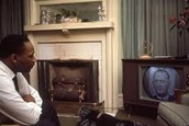 MLK waching the speach from the president