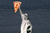 When did the first pizzeria opened in America? Where was it located?