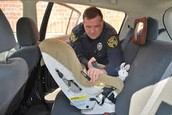 Police Officer Giving free Car Seat Inspection