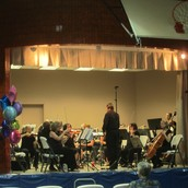 The Orchestra warming up.