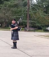 Coolest bagpipe player ever!