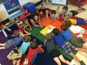 Reading a story with Miss Courtney!
