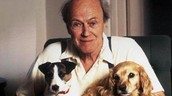 Roald Dahl holding his two dogs