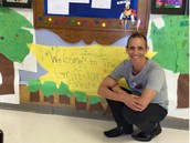 Mr. Griffiths poses with a tree house made by our students