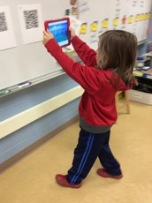 Miss Larsen's Students Scan QR Code Clues to Make Predictions About ELA Module