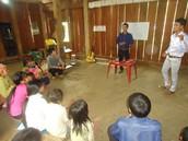 Khoa teaching apostolic doctrine to a youth group.
