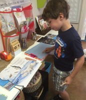 Gavin reading about bears for his journaling