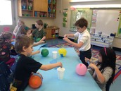 We are using balloons and blue paper to make the oceans