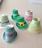 He shrank our hats!  They were 8oz cups and now they are the size of hat a leprechaun could wear!