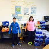 5th grade stacks up a pile of water bottles!