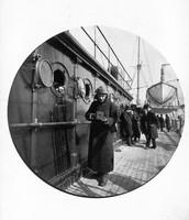George Eastman holding a Kodak camera