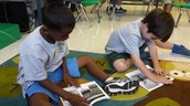 "James and Kenzo partner reading ""The Apple Tree!"""
