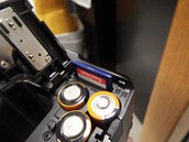 SD card insertion/battery placement
