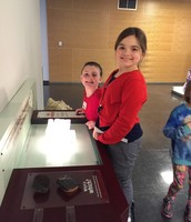 Alaina and Gabby looking at minerals