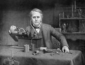 Thomas Edison building the Phonograph.