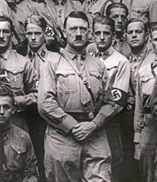 Hitler (in the middle) standing with the Nazis.