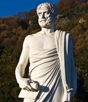 A stone statue of Aristotle.
