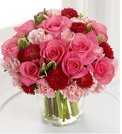 Sometimes pink roses or carnations will be added but almost always the main flower will be red roses.