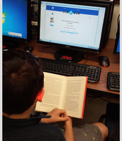 "One of my students using Learning Ally!  He's reading ""The Dragon on the Lonely Island""."
