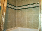 Porcelain, glass, and stone tiled shower