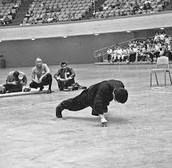 Bruce Lee doing two finger push ups.