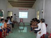 Khoa, teaching a church group apostolic doctrine.