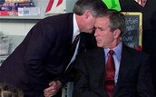 Bush being told about 9/11 attacks.
