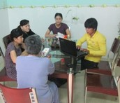 Lin's family in Vietnam being taught salvation by Khoa and his friend, Doc.