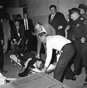 JFK being take to the hospital