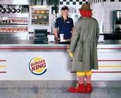 Ronald McDonald eating at Burger King.