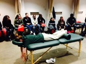 A massage demonstration and presentation is given to students.