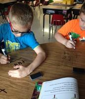 Working hard on 2-digit addition!