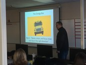 Staff presenting the 10 Rules of the The Energy Bus