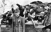German Officer with Dead Bodies